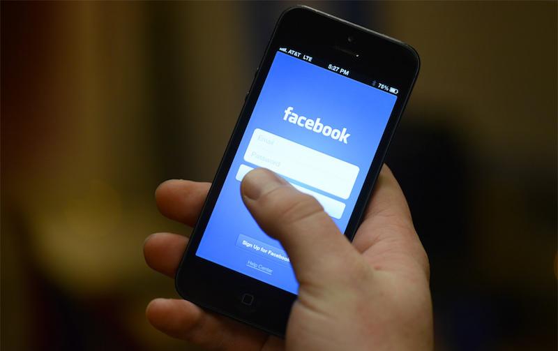 An iPhone at the Facebook login screen