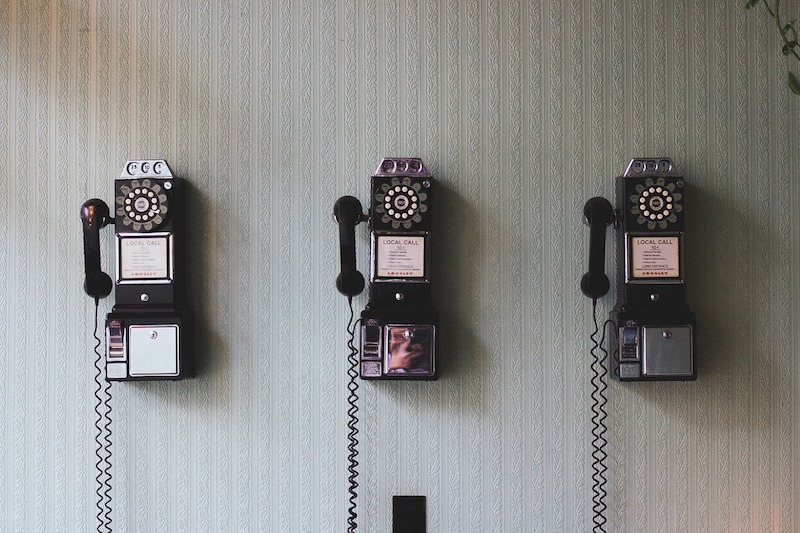 Three old rotary phones in a row